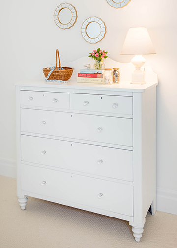 We encouraged our clients to not give up on their treasure furniture piece. We fixed the drawers so they would slide open without struggle, painted it white, added glass knobs, and removed the small mirror attached. It is back working order and moved into the 21st century.