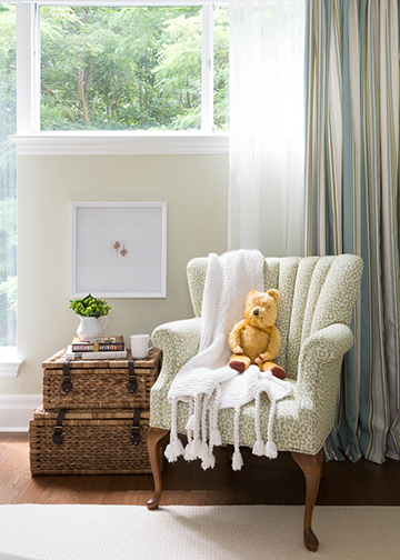 When we recovered the chair in a fun green animal print and placed it in the guest bedroom, it added some fun to an otherwise serious space. This chair is perfect for guests to sit down and relax or read.