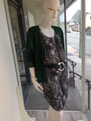 This Spring it's all about mixing black and white in print and textures. We love this silk tribal print shift dress belted loosely at the hip. Throw on a this gorgeous green loose gage cotton cardigan for a pop of color.