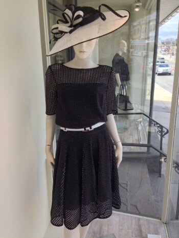 This two piece laser cut neoprene look is just fabulous. An all black look is contrasted by the white inside the fabric peeking out of the perforations. We completed the outfit with a gorgeous fascinator and a slim white belt to accentuate the waist line.