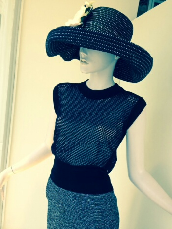 We love this rolled brim dotted hat with the silk flower paired back to an edgierlittler perforated knit vest and tweed pull on pencil skirt.