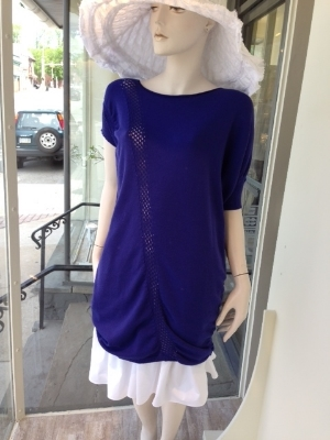 Tunics are not just for leggings anymore.  We love the idea of this white cotton fuller skirt layered under this plum asymmetric knit tunic for a new and fresh silhouette.