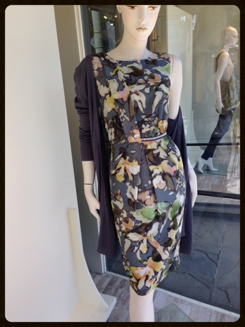 This gorgeous print cotton sateen sheath is very flattering with touch of beading to highlight the waist line. We draped a long, cotton and linen, blue cardigan over her shoulders to complement the dress's print.