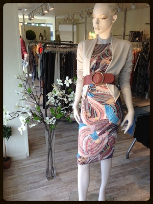This beautiful jersey print sheath is sleeveless with a bateau neckline.  We threw on a stone colored open cardigan and used a fabulous rose leather waist belt to top off the look.