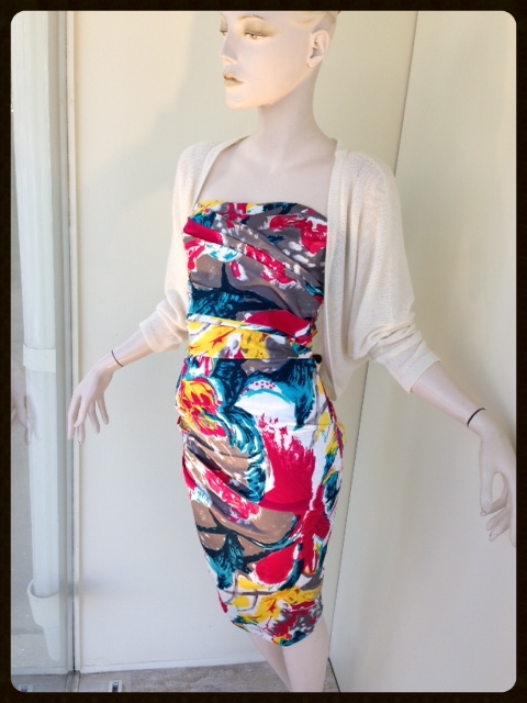 We absolutely love this stretch cotton strapless print dress. Add an ivory cashmere bolero for a barely-there sleeve to complete the look. Inquire with us about other prints available in this same silhouette!