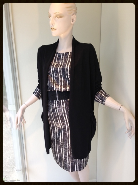 Prints and textures will take you from summer to fall seamlessly. This black and cream silk twill dress is an easy summer shift with a sandal and can easily be paired back to a long black textured cardigan and bootie for fall. Add a belt to bring the whole outfit together.