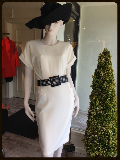 Forget the old rule about no white after labor day...Winter whites are an important staple this Fall and we just love this cream lightweight wool sheath. To accentuate a slim waistline, we added this cool black and cream dotted leather belt and finished the look with a fabulous hat!