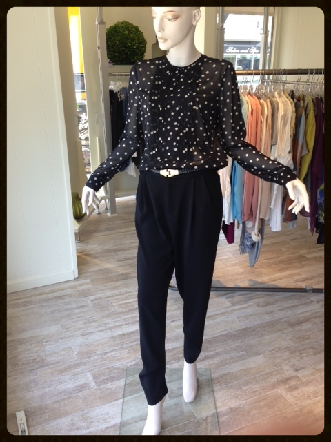 These crepe boyfriend trousers contain no wool and can easily transition you from summer nights to the fall. Soft blouses tuck nicely into a draped front pant as shown with a great sheer polka dot blouse.