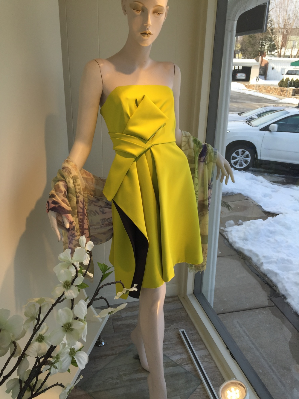 This gorgeous chartreuse strapless dress from Halston Heritage is a double faced fabric so you have a contrast of navy satin peeking through the draping.  So great!