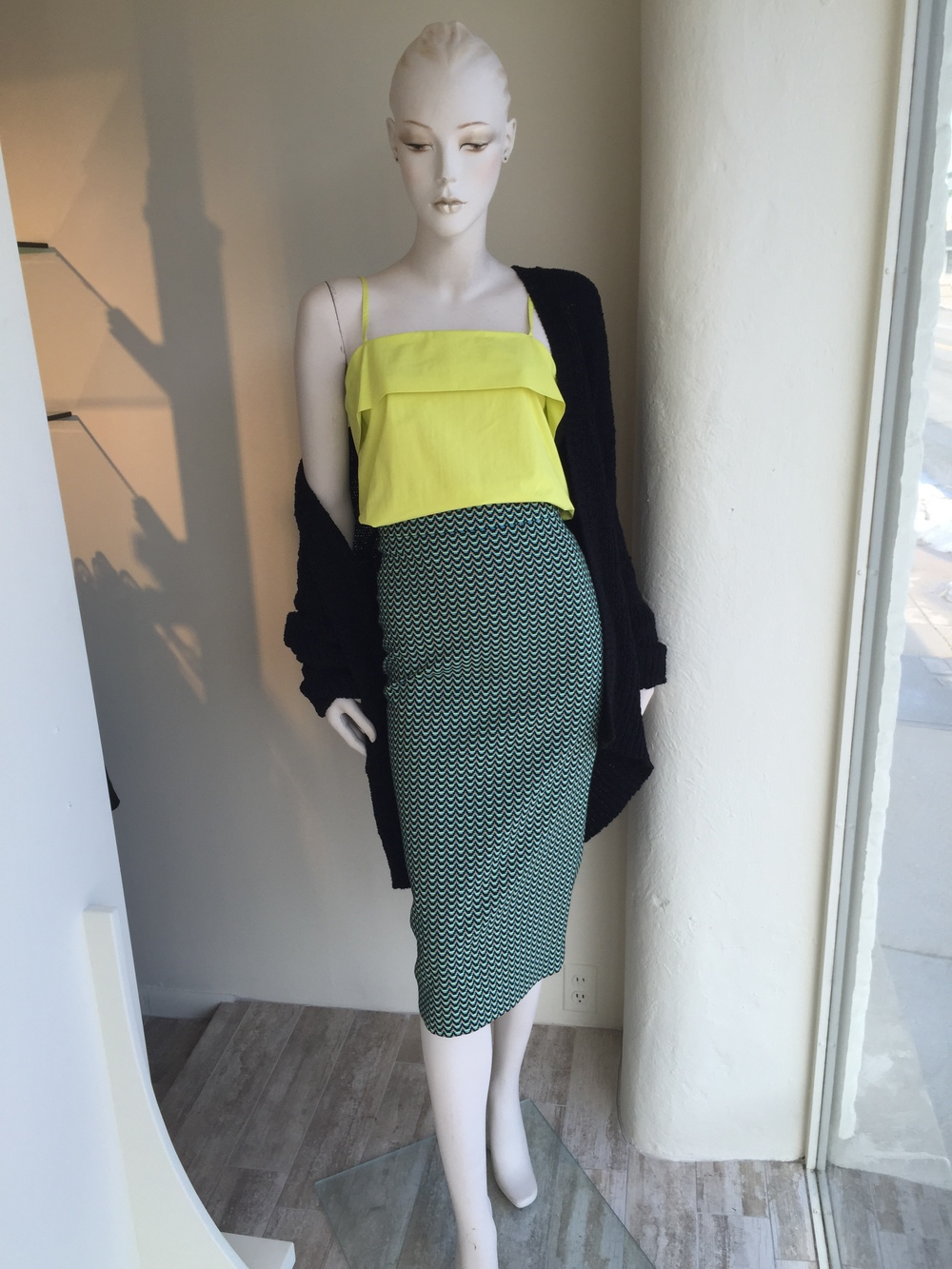 With hemlines getting longer, we love this long tapered pencil skirt from Hache in a geometric pattern.  The chartreuse cotton cami picks up the color in the skirt and a nubby knit cardi from Nili Lotan completes the look.