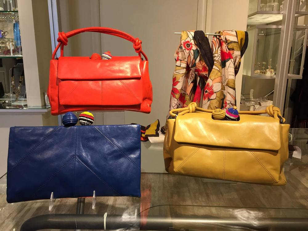 Our Italian sportswear collection, Maliparmi, has arrived in store and the accessories are fabulous. In addition to the gorgeous print scarves, we absolutely love the leather satchels and clutches with beaded ball closures. Stop in today for beautiful color options.