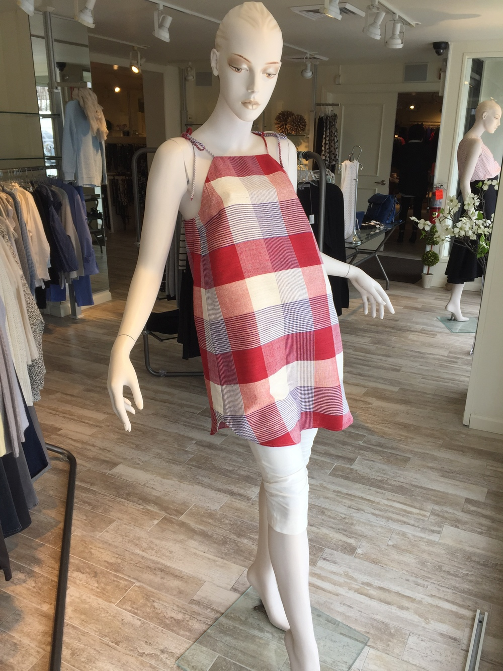 This plaid linen tunic with little ties at the shoulder from Litke can be a dress on it's own for some or can be paired back to a long short or skinny jean for a cool, easy summer look.