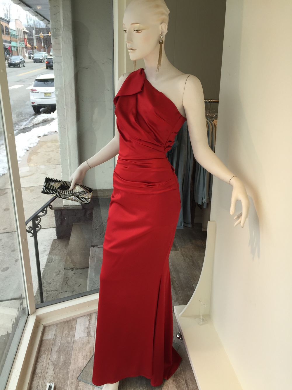 Also from Talbot Runhof, we can customize this beautiful one shoulder draped gown to your color and size preferences.