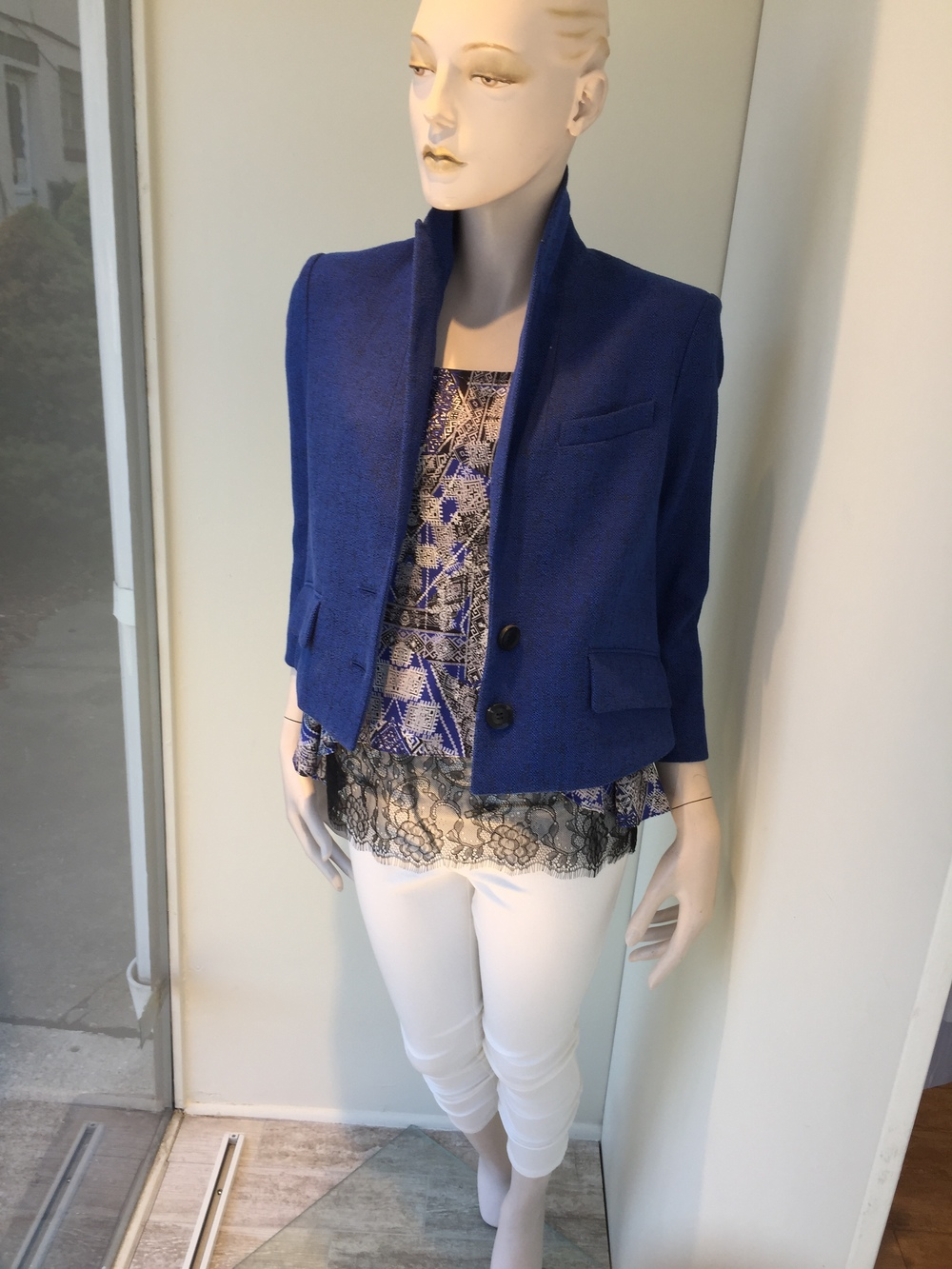 Marissa Webb makes an impeccable jacket...This gorgeous blue crop piece has a split in the back for a little bit of edge. We layered a print silk blouse from Marissa Webb over a lace camisole and finished the look with a white cotton pant from Veronica Beard.