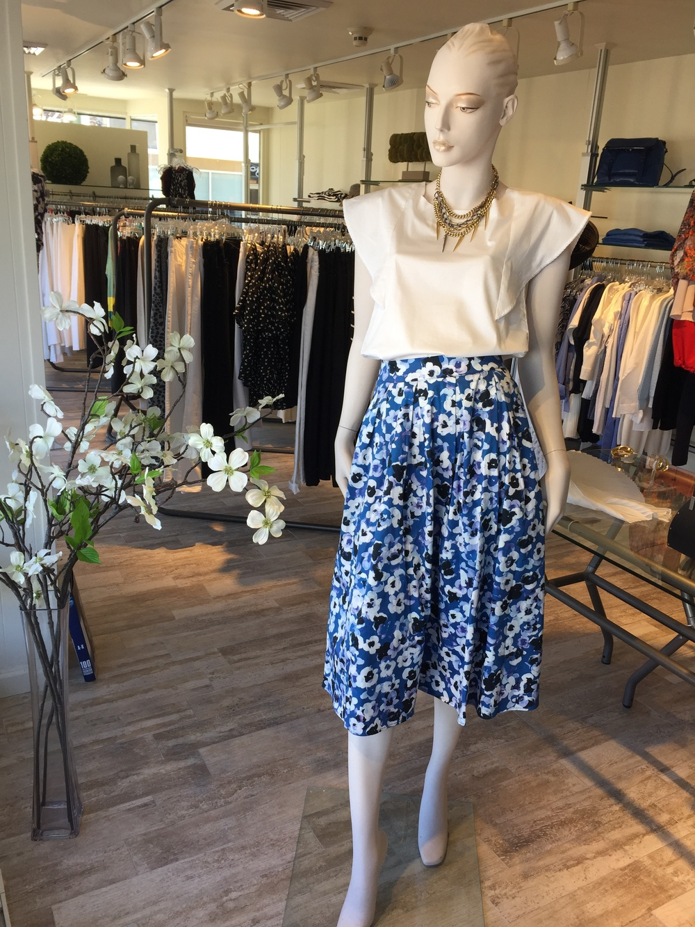 This is a great daytime occasion look from Sam & Lavi...the floral print full skirt looks beautiful with the ruffled cap sleeve cotton shirting tucked in loosely. The skirt can also be paired to little loose tees for a more casual feeling.
