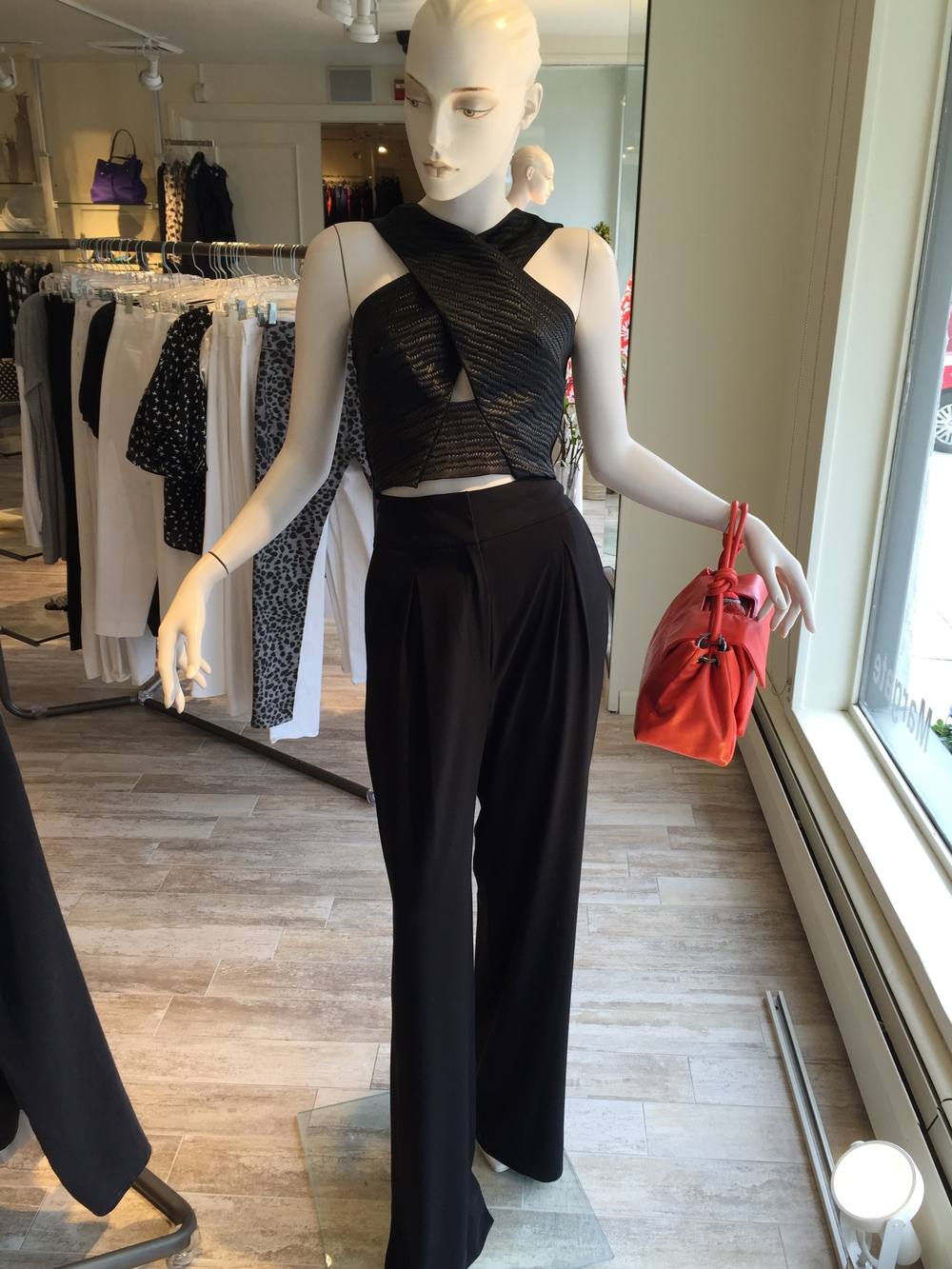 This is a great going out look from L'Agence...the crossover top shows just a bit of bare midriff without being vulgar and the long flowy pant balances the sexier top!