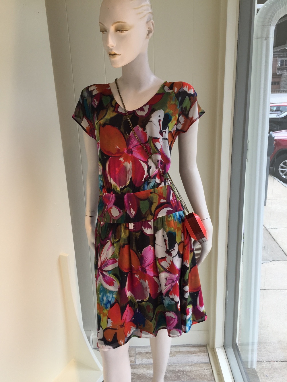 This floral chiffon print dress from Rene Lezard it really beautiful with it's drop waist line.  This one can be an occasion dress or just an easy summer dress with a sandal.