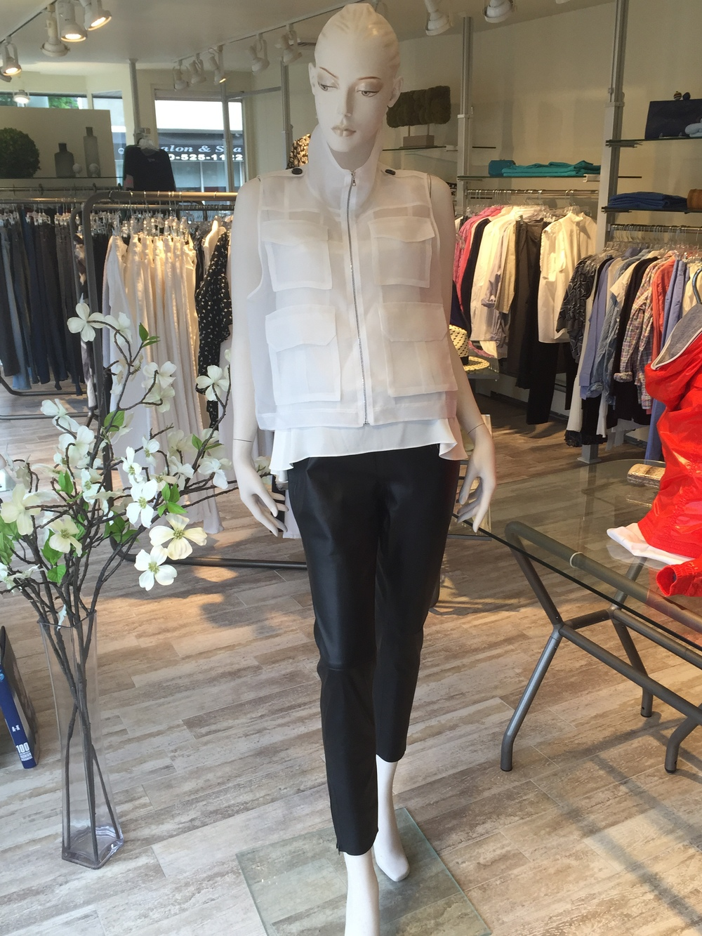 The white organza cargo vest from Marissa Webb is a great topper over little camisoles or summer dresses. Here we layered it over a white silk button-back blouse, also from Marissa Webb, and paired them back to a leather trouser from Maliparmi.