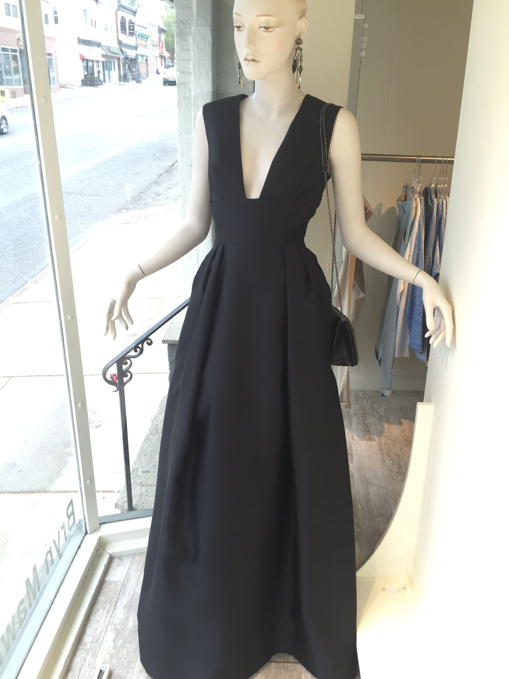 This deep v-neck, full skirt gown in a silk and wool fabric can be customized to suit your event needs. We can order this piece in colors and can also fill in the neckline with a lace detail if it is lower than your preference.
