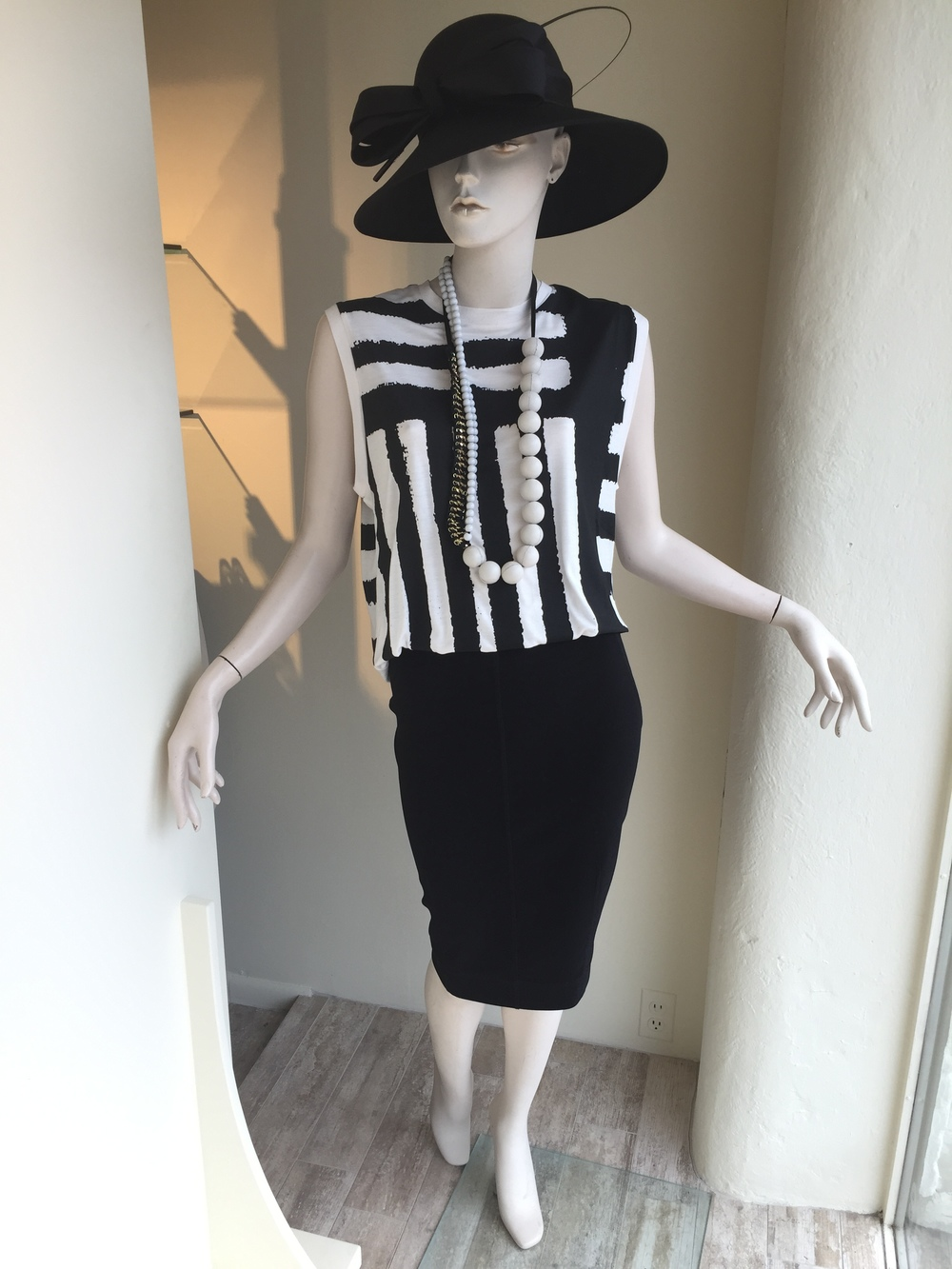 This novelty tee is a great piece back to jeans or a little cotton pant and also works dressed up slightly with a pencil skirt as shown. This entire look , including the necklace, is from designer By Malene Birger.