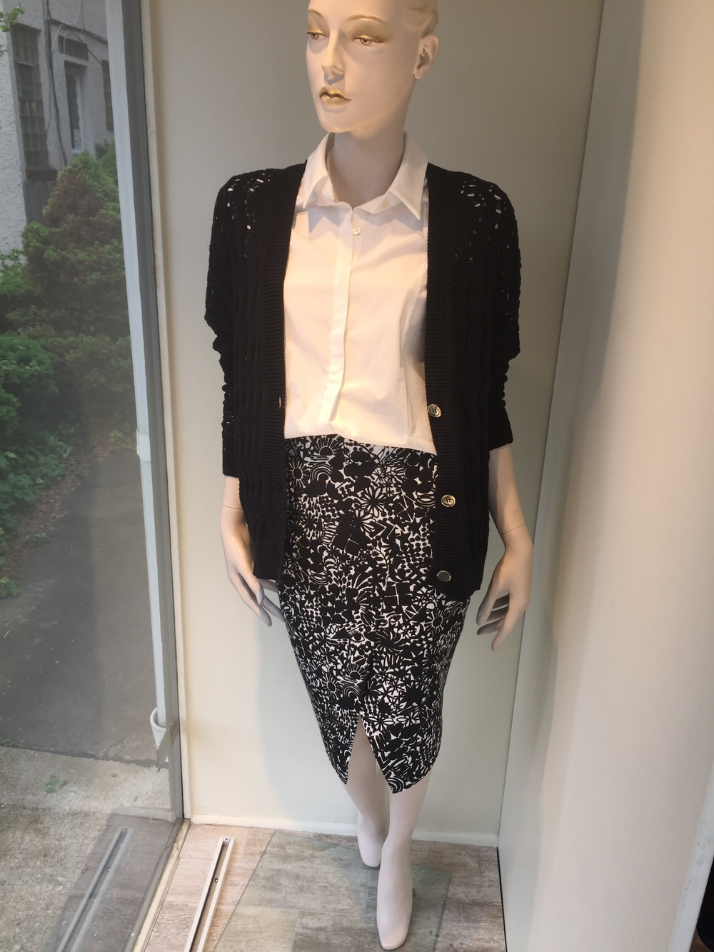 We love the split front detail of this print pencil shirt from Whit. Here we are showing it back to a little cotton shirting and a loose weave black cardigan from Allude.