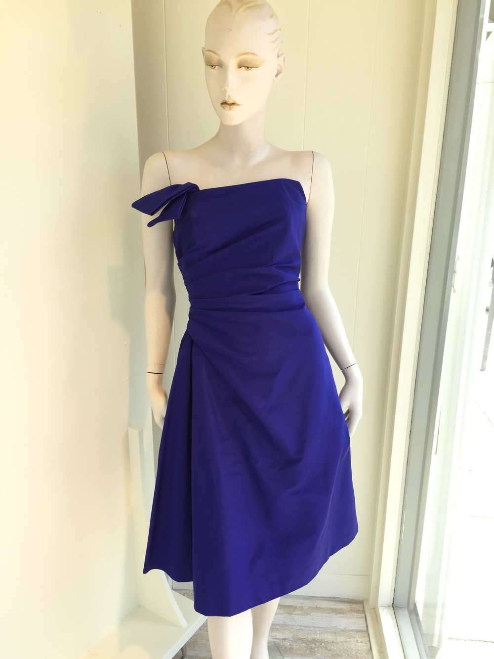 This is a gorgeous silk faille cocktail dress with an asymmetric neck and draped full skirting.  Here it is in a gorgeous lapis color, but we can order other colors as well.