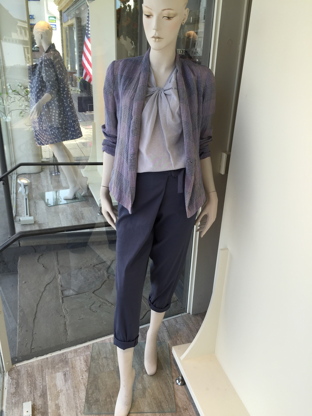 This plaid linen jacket from Lilith is both a gorgeous color and great lightweight fabric.  Here we have it shown over a knotted neck cotton blouse and paired back to an indigo cotton trouser with a tie waist.