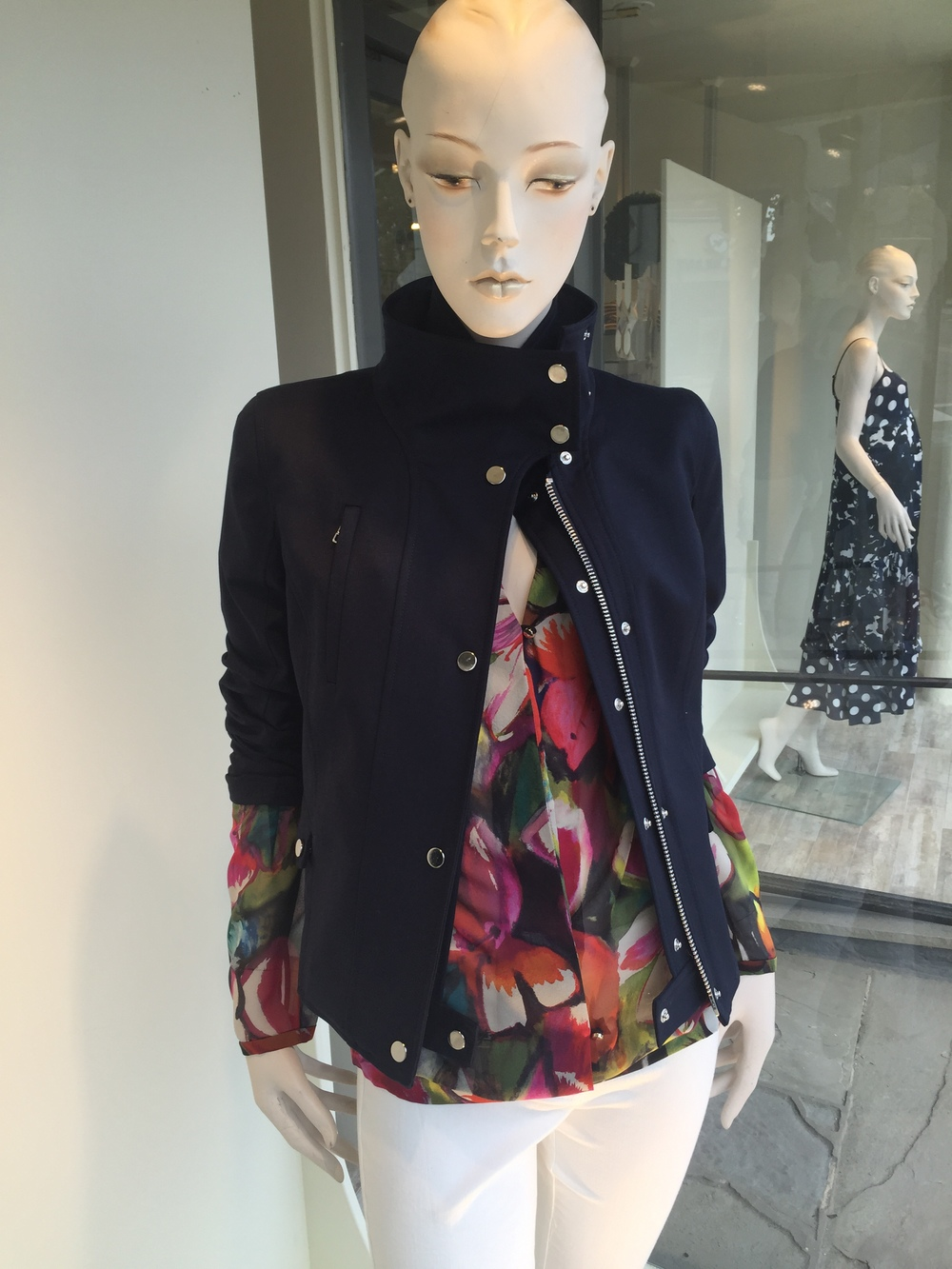 This is a three season navy jacket from Veronica Beard in a cotton stretch.  We have it layered over a floral silk surplice blouse from Rene Lezard and paired back to the Veronica Beard white stretch denim skinny jean.