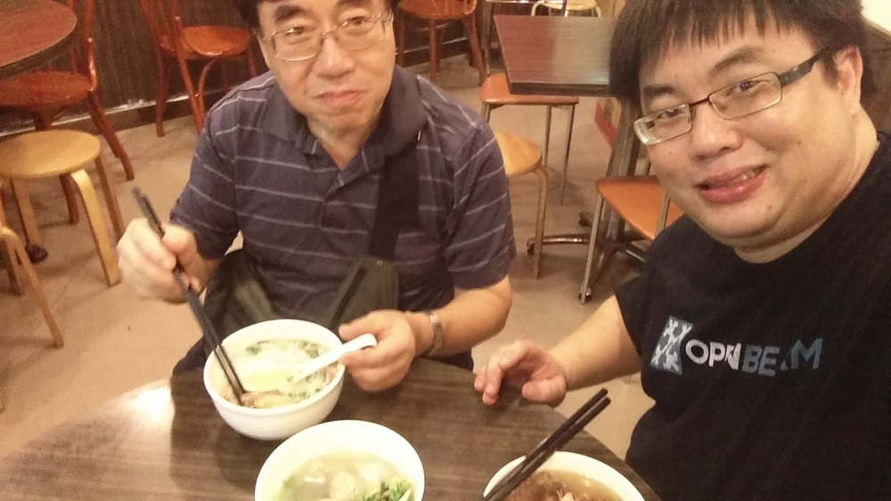 "Dad and I having a celebratory bowl of beef brisket noodles in soup, with a bowl of fish-skin dumplings, right before visiting the local hackerspace, aptly named ""Dim Sum Labs"", night before departure.  Traditional wonton noodles are made by repeated pressing of a dough with a bamboo stick in an up-and-down motion to develop the gluten and gives the noodle a very springy texture - reasonable substitutes exists in the US, but the real thing is impossible to find.  The fish skin dumpling hails from Chiuzhou - the skin is made by mixing minced fish meat with tapioca starch, while the filling is actually pork.  Also impossible to find in the US"