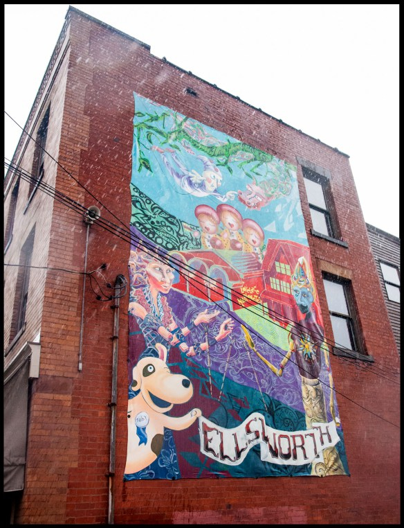 Photographed by: Kim Willen    The 13′x21′ canvas mural is an homage to Margo's contribution to Pittsburgh. It is Installed on Kozloff and Meaders, an antique shop located at 5883 Ellsworth Avenue.  The characters depicted in the mural are derived from her original productions.