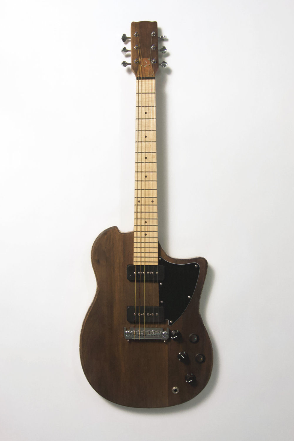 "Spong Jr. Black Guitar / Walnut, Maple, Copper, ABS / 30"" x 14"" x 2"" / 2017      Specs – P90 pickups, Wilkinson 16:1 Tuners, 1 vol 2 tones (0.047uF orange drop, 0.1uF metalized polyester)"