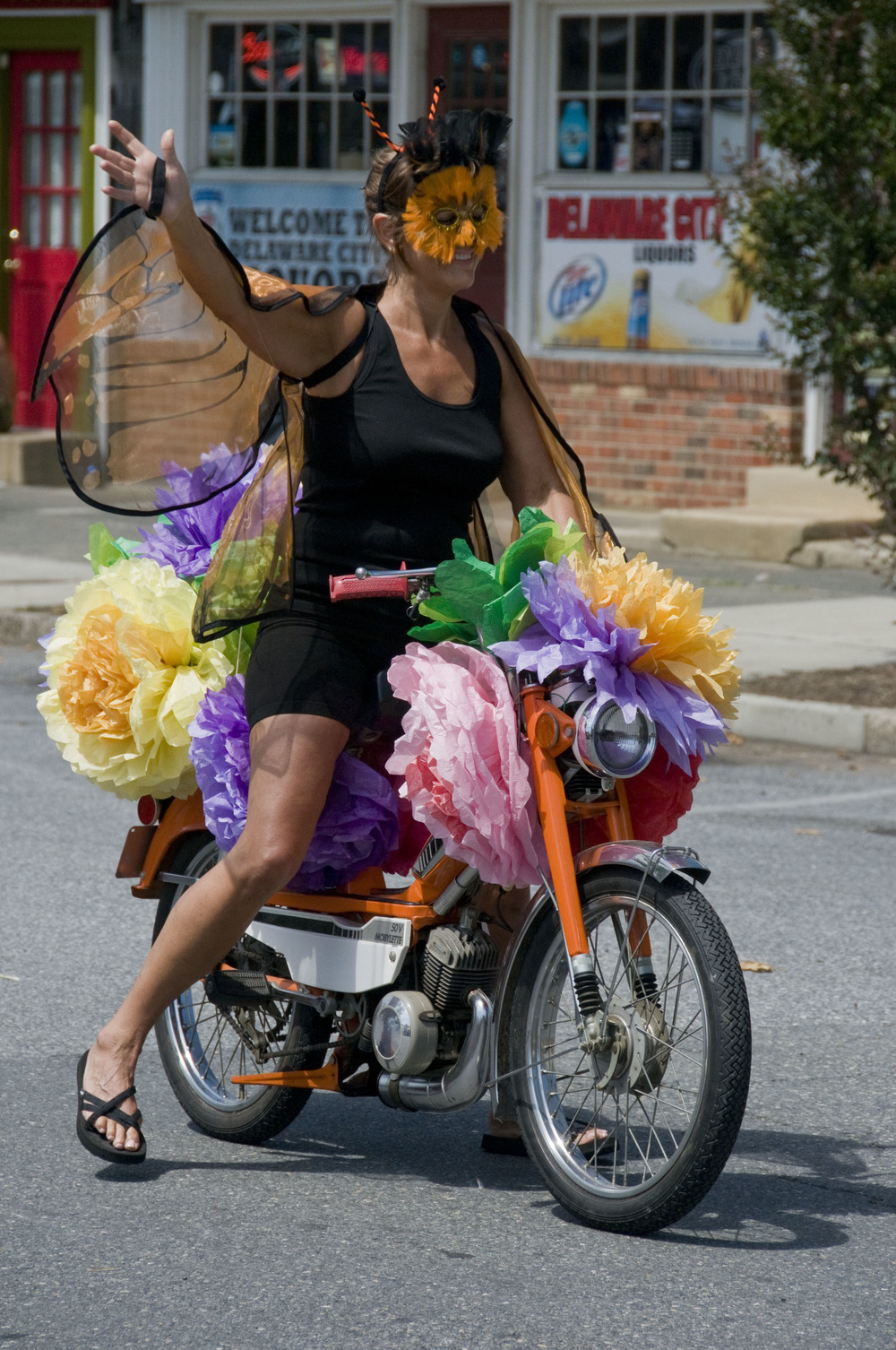 colorful moped rider