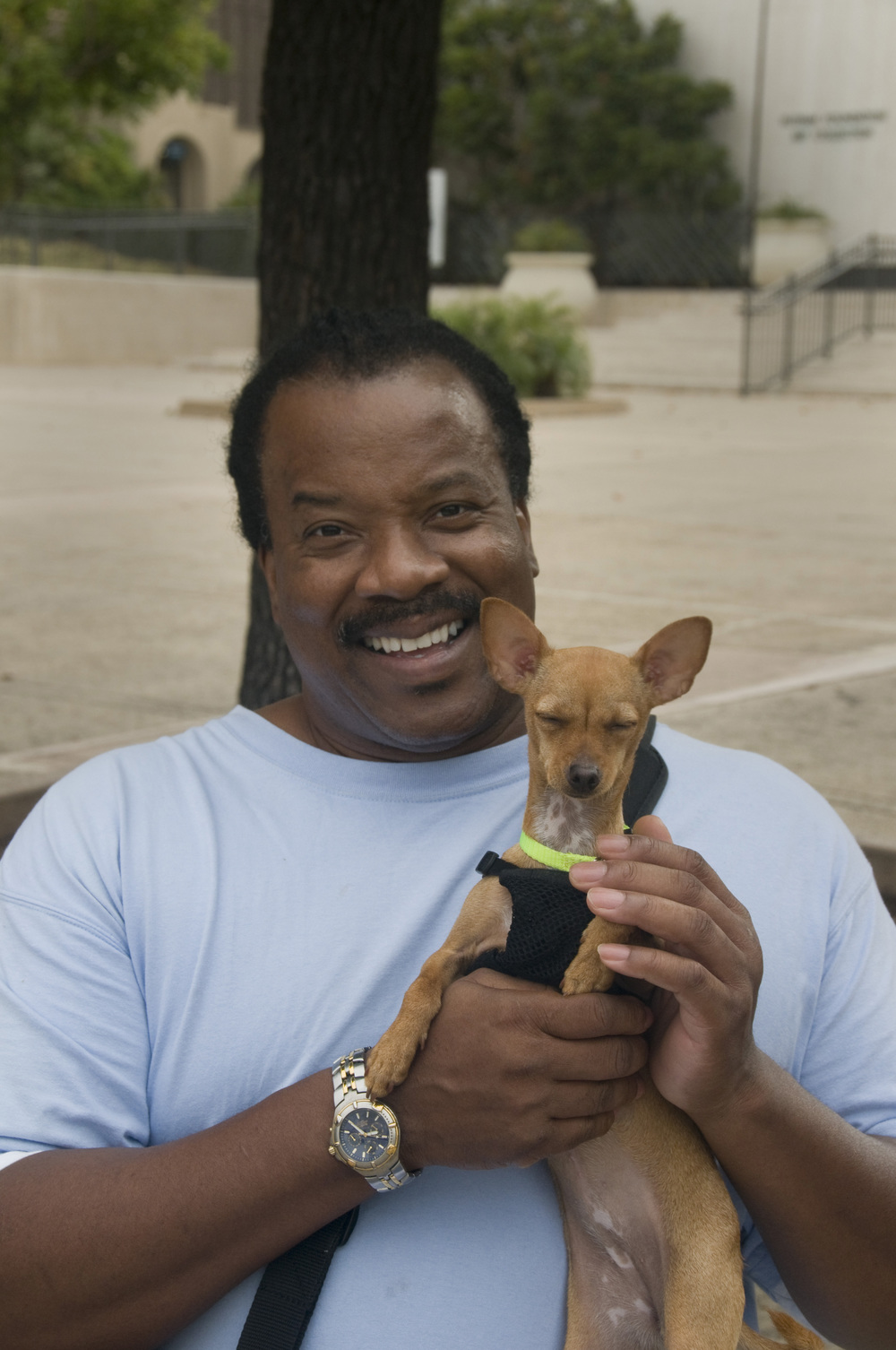 man with Chihuahua