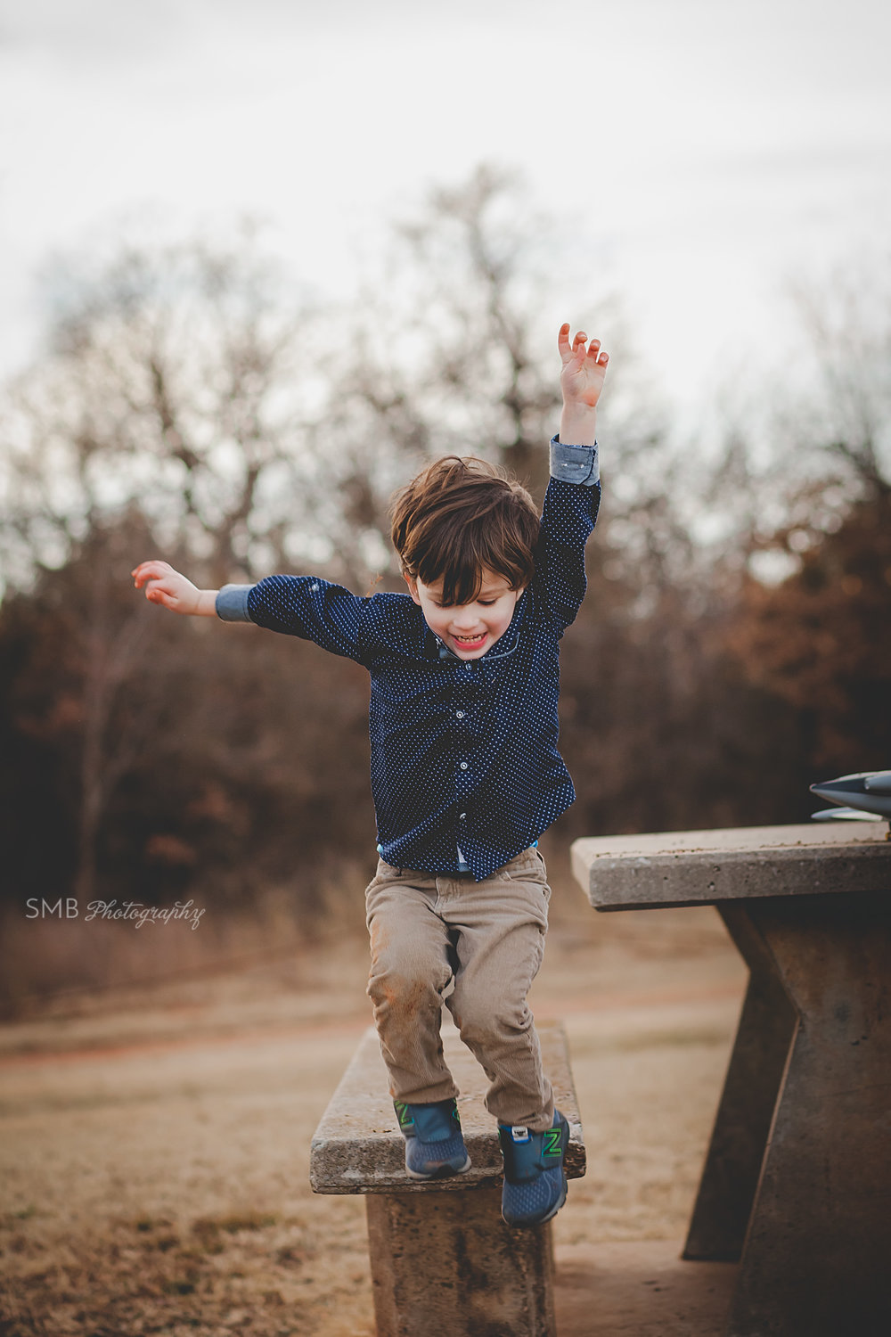 Little boy jumping off table having fun