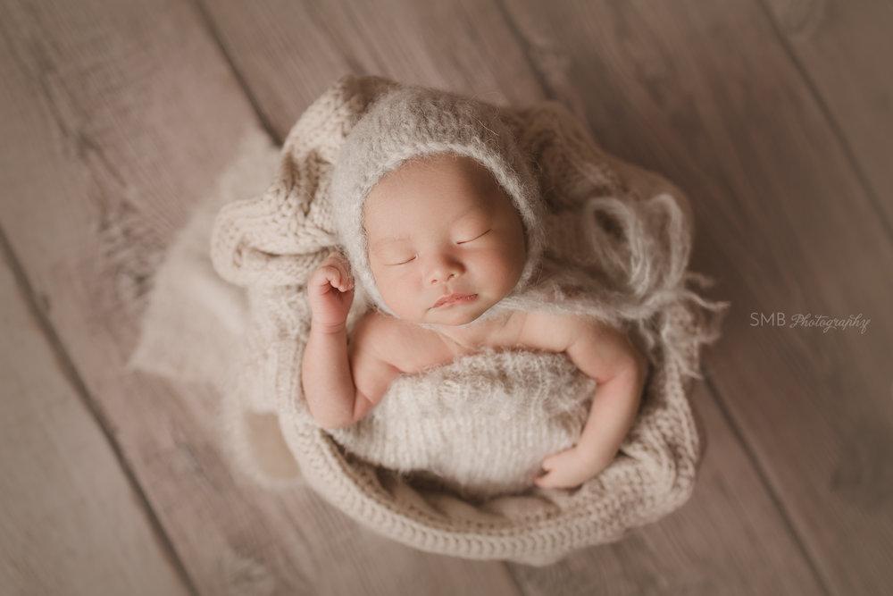 Baby in bucket sleeping