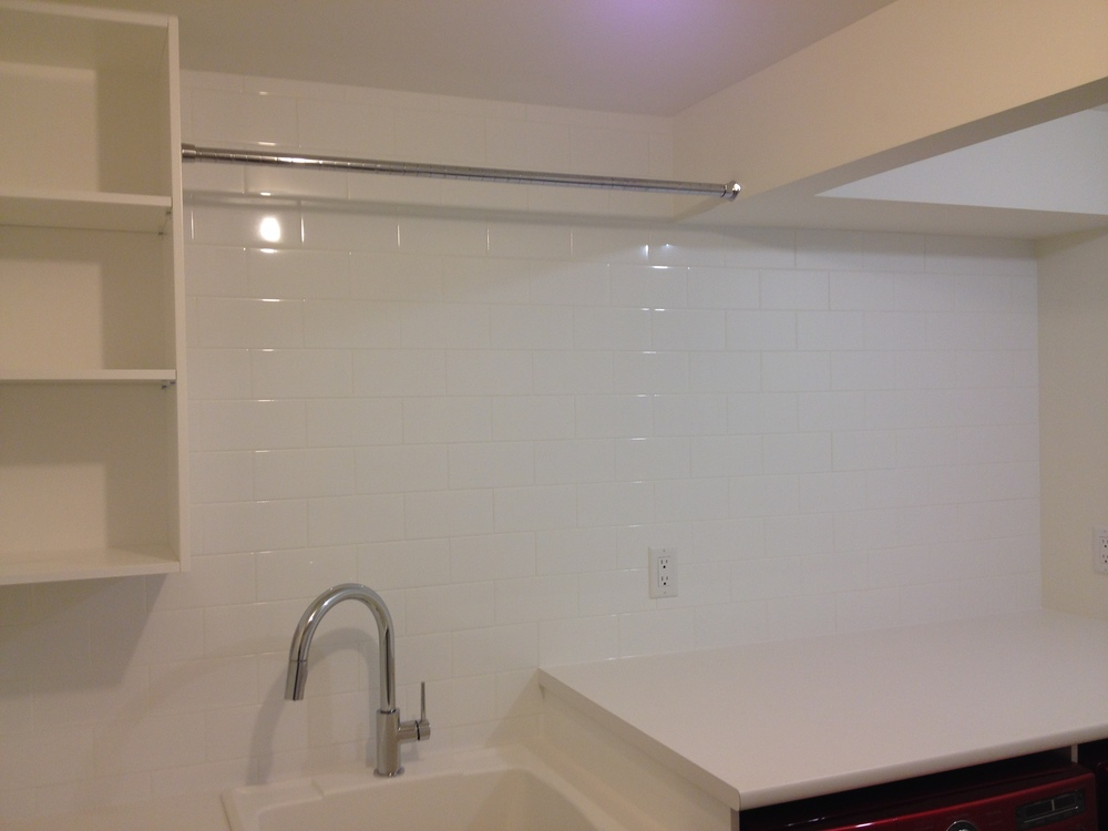 Laundry Room, Hanging Rod, White Tile to Ceiling