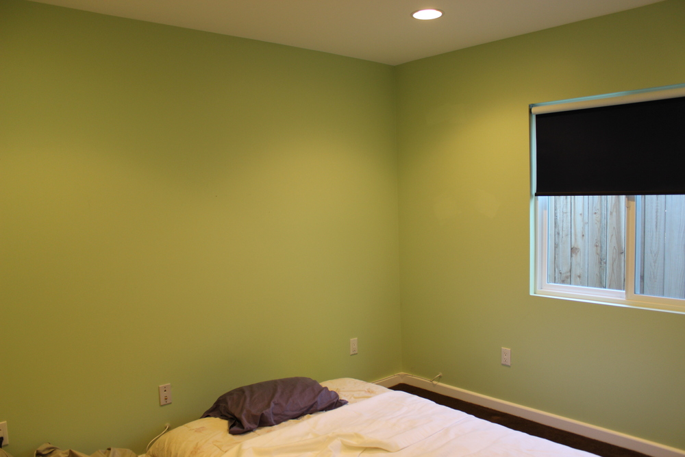 "As a reminder, here's a ""Before"" of the space: a green paint color from the previous owners, a dark black shade, and pretty much nothing else. After (above and to left) colorful, happy and functional."