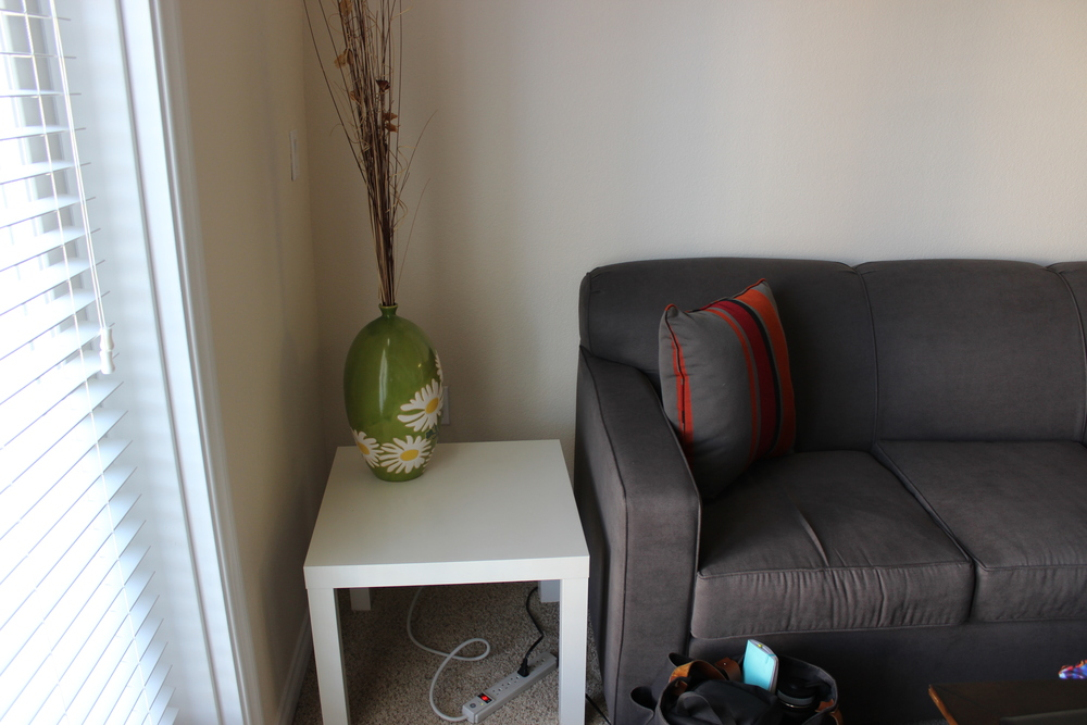 "As a reminder, here's a ""Before"" of the space: a mix and match of furniture pieces, pillows, and decor."