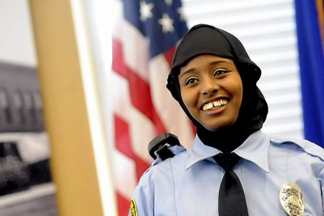 Kadra Mohamed is the first Somali-American woman to become a police officer in St. Paul. The department has allowed her to wear the hijab.