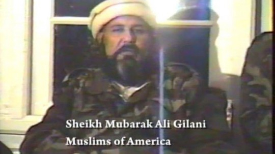 Sheikh Mubarak Gilani of Pakistan is the founder and leader of MOA. He is shown here in a video inviting Americans to join his guerilla training camps in the United States.