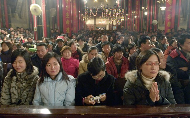 Christian congregations in particular have skyrocketed since churches began reopening when Chairman Mao's death in 1976 Photo: ALAMY