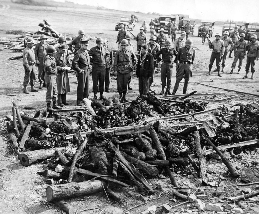 Photo: April 12, 1945: Generals Eisenhower, Omar Bradley and George S. Patton inspect, at Ohrdruf forced labor camp, an improvised crematory pyre.
