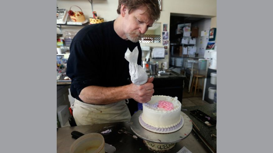 Masterpiece Cakeshop owner Jack Phillips decorates a cake inside his store, in Lakewood, Colo.AP Photo/Brennan Linsley, file
