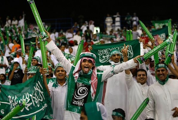 Saudi supporters at World Cup Asian qualifying playoff soccer match.
