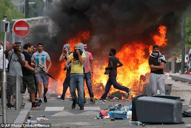 Rioters face riot police, following a pro-Palestinian demonstration, in Sarcelles, north of Paris, on Sunday.