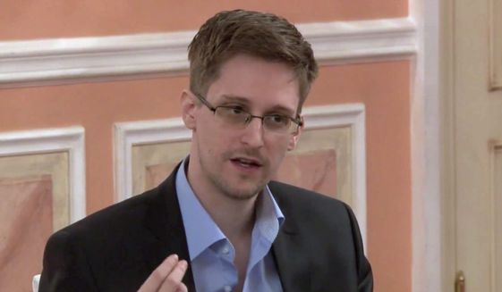 ** FILE ** In this image made from video released by WikiLeaks on Friday, Oct. 11, 2013, former National Security Agency systems analyst Edward Snowden speaks during a presentation ceremony for the Sam Adams Award in Moscow, Russia. (AP Photo)