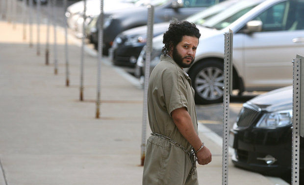 Mufid Elfgeeh is taken from his arraignment in federal court in Rochester, NY, Monday June 2, 2014. (The Rochester Democrat & Chronicle via The Associated Press)
