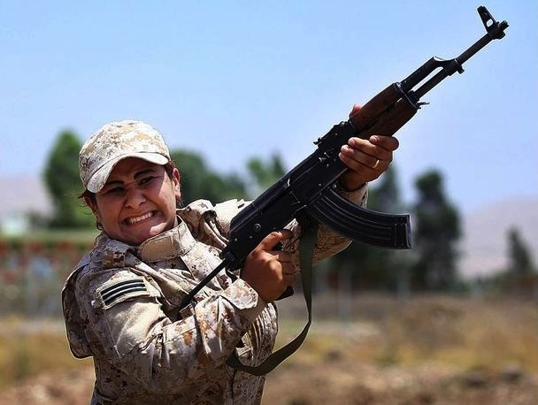 In this Thursday, July 3, 2014 photo, a woman from an elite unit of female Kurdish Peshmerga fighters trains in Sulaimaniyah, 160 miles (260 kilometers) northeast of Baghdad, Iraq. Some Kurdish women living in Northern Iraq are training to be peshmerga, as the self-ruled Kurdish region's militia is known, to fight against the imminent threat of Islamic militants and to protect their land. (AP Photo)