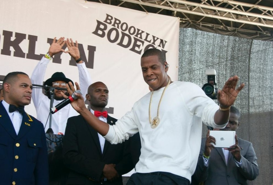 Jay Z performs with Jay Electronica at the Brooklyn Hip-Hop Festival,flanked by members of the Fruit of Islam.