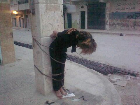 """This Syrian woman was killed by the Islamic State (when they carried the glorified name """"rebels"""") in the town of Sheikh Massoud, Aleppo region, for being caught with a beer. She was then tied up with her ID card placed by her feet to identify her and her family, put next to a sign asking people to spit on her."""